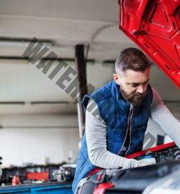 man-mechanic-repairing-a-car-in-a-garage-.jpg